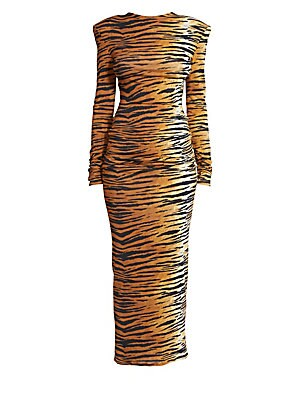 Image of An elegant column silhouette is paired with a bold tiger print in this statement gown. A stunning structured shoulder anchors both the bold print and the bodycon fit. Roundneck Long sleeves Padded shoulders Center-back zip Viscose/elastane Dry clean Made