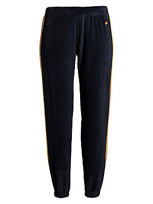 """Image of Bold racing stripes lend athleisure cool to these sumptuous velour joggers. Elasticized waist Pull-on style Side seam pockets Elasticized cuffs Polyester/spandex Machine wash Made in USA SIZE & FIT Rise, about 10"""" Inseam, about 28"""" Leg opening, about 8"""" M"""