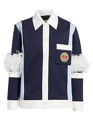 Image of Ostrich plumes burst forth from the elbows of this button front jacket, injecting it with forward-thinking appeal. The body of the jacket itself references 70s workwear, pairing contrasting panels with bubble lettering. Point collar Long sleeves Buttoned