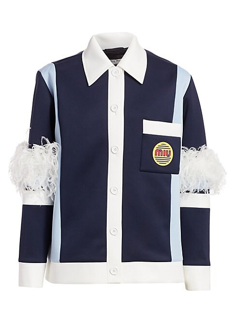 Image of Ostrich plumes burst forth from the elbows of this button front jacket, injecting it with forward-thinking appeal. The body of the jacket itself references 70s workwear, pairing contrasting panels with bubble lettering. Point collar. Long sleeves. Buttone