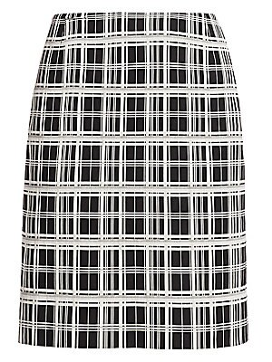 Image of A bold black-and-white check is broken up with slices of silver on this smart pencil skirt. Dress up with mixed metal accessories to bring out the metallic element. Concealed back zip closure Lining: Cupro Viscose/polyamide/elastane Dry clean Imported of