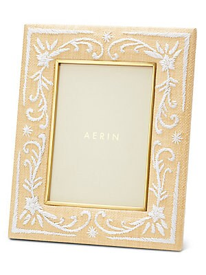 Image of Inspired by bamboo and raffia designs paired with brass and bronze from the 1970s, this attractive frame elevates smaller photographs. The natural appeal of woven raffia is further enhanced with an embroidered floral motif and a brass edging. Embroidered