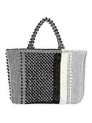 """Image of Artisanal in its woven two-tone construction, this spacious tote is the quintessential bohemian accessory. Top snap tab closure Silvertone hardware One interior slip pocket Fully lined Cotton/linen Made in Italy SIZE Double top handles, 6.3"""" drop 17.32""""W"""