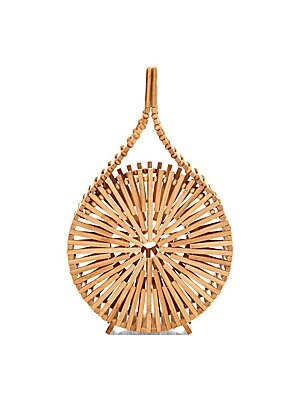 """Image of Artisanal bamboo constructs eclectically round top handle bag for a boho aesthetic. Top handle Top magnetic closure Bamboo Spot clean Imported SIZE Top handle, 2.25"""" drop 6.25""""W x 10.25""""H x 3""""D. Handbags - Contemporary Handbags. Cult Gaia. Color: Natural."""