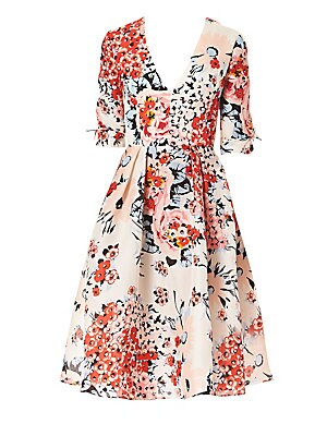Image of A lush floral print and delicate bows at the sleeves adorn this ultra-feminine tea dress. The perfect piece for a garden party, it features a modestly romantic fit-and-flare silhouette cut from an exquisite light-as-air silk. V-neck Elbow-length sleeves C