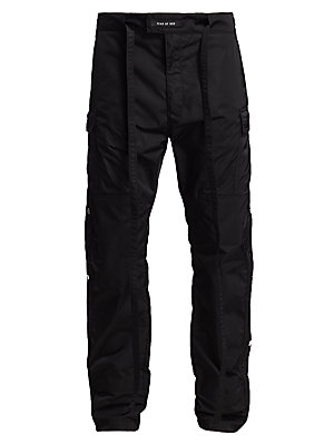 Image of Hero pant of the 6th collection, these pants with classic cargo pocket detailing feature a new luxury update. Cobraz snaps and metal zip along the outseam and finished in Japenese nylon. Belt loops with self tie Zip fly with concealed closure Side flap ca