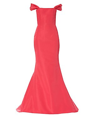 Image of A bright coral hue lends an exuberant quality to this silk gown with a sweet off-shoulder neckline. A structured bodice nips in the waist before the fabric trumpets out into a mermaid silhouette. Off-the-shoulder Short puff sleeves Concealed back zip clos