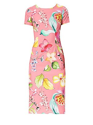 Image of An animated floral print enlivens this short sleeve dress. Flaunting a knee-length sheath silhouette, the dress is cut from a stretch cotton for a comfortable fit. Roundneck Short sleeves Concealed back zip closure Back slit Cotton/elastane Dry clean Made
