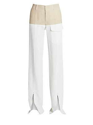 Image of Effortlessly chic, these wide-leg trousers are crafted in a lightweight stretch linen blend and finished with a colorblock design. An oversized cargo pocket and zippered wide-leg work to create a pant that works for the modern woman. Belt loops Zip fly Si