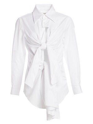 Image of An update on your classic white button-down this crisp cotton poplin iteration flaunts oversized multi front ties for a modern look. Skin-baring cut outs create an avant-garde piece that falls to an asymmetric hem. Point collar Long sleeves Front two butt