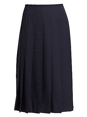 Image of An A-line midi skirt with a daring side slit is crafted of a lightweight wool-blend. Sophisticated pleats with undone edges add quirky appeal to this modern essential. Raw-edge waistband Concealed back zip Pleated Side slit Polyester/wool Dry clean Made i