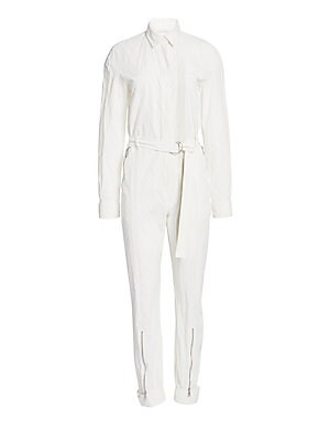 Image of Cut from stretch cotton, this jumpsuit flaunts a utilitarian aesthetic. Wear over a fitted top in a bright hue for an outfit that pops. Point collar Long sleeves Buttoned barrel cuffs Zip fly with concealed button front Waist zip pockets Self-tie at waist