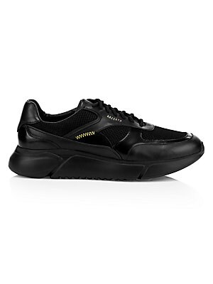 Image of Breathable mesh panels lend sporty appeal to a pair of rich-leather sneakers modernized by a chubby midsole. Leather upper Round toe Lace-up vamp Side logo detail Contrast stitching Leather lining Padded insole Rubber sole Made in Portugal. Men's Shoes -