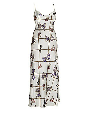 Image of A knowingly kitschy crystal-studded bow print decorates this silk slip dress. A side slit is sliced high for a revealing silhouette. Draped scoopneck Spaghetti straps Pullover style Side slit Silk Dry clean Made in Italy SIZE & FIT Fitted silhouette About