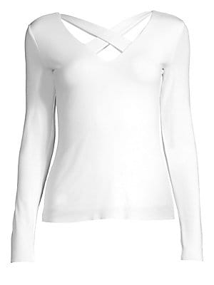 "Image of A stylish cutout front modernizes this everyday top styled with long sleeves and a stretchy fit. Criss-cross V-neck Long sleeves Pullover style Rayon/spandex Dry clean Made in USA SIZE & FIT About 22.5"" from shoulder to hem Model shown is 5'10 (177cm) wea"