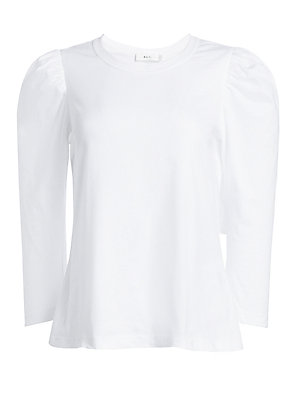 """Image of Bold puff sleeves lend structural textures to this billowy blouse. Roundneck Three-quarter puff sleeves Pullover style Cotton Machine wash Made in USA SIZE & FIT About 23"""" from shoulder to hem Model shown is 5'10"""" (177cm) wearing US size Small. Contempora"""