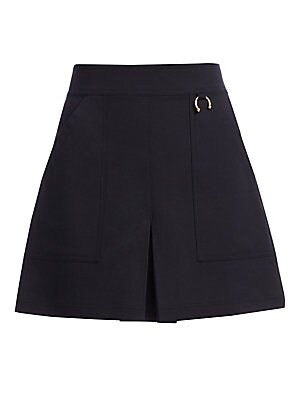 Image of Cut with stylish patch pockets and a skort-like design, this cute A-line skirt is perfect for office-to-weekend looks. Banded waist Back zip Goldtone horseshoe embellishment Seamed detail Front patch pockets Front vent Back flap and welt pockets Cotton/te