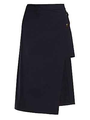 Image of A refined midi-length pencil skirt is slashed to the thigh revealing a concealed mini hidden underneath. Finished with hammered brass tone buttons and crafted of a luxurious lightweight stretch virgin wool, this skirt embodies elegance with a youthful twi