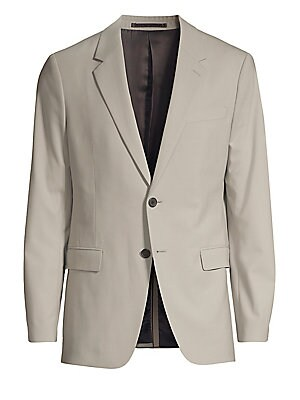 Image of The Chambers jacket is a structured cut with peak lapels, two-button closure, and flap pockets. This single-breasted jacket is woven in premium stretch wool with a water-resistant finish from one of Italy's finest mills. Notch lapel Long sleeves Button fr