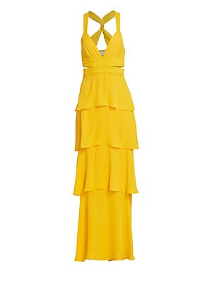 Image of Romantic tiered-ruffle maxi modernized by an elegant twist-back, side cutouts and a daring plunge neckline. Plunging V-neck Sleeveless Shoulder straps Side zip closure Side hook-and-eye closure Ruched waist band Back cutouts Lined Silk Dry clean Imported