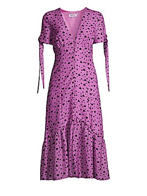"Image of Allover heart print adorns pretty midi dress with tie sleeves and button front. V-neck Short tie sleeves Button front Ruching details Flounce hem Lined Polyester/silk Dry clean Made in USA SIZE & FIT Midi silhouette About 46"" from shoulder to hem Model sh"
