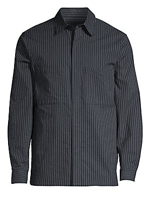 Image of A relaxed-fit shirt jacket with a point collar, covered button front closure, and dual chest pockets. This shirt jacket is woven from a soft Italian cotton and linen blend with a touch of stretch and a yarn-dyed stripe. Point collar Long sleeves Concealed