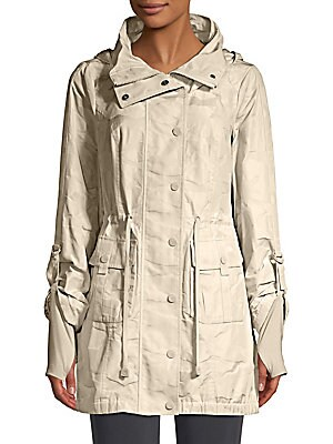 Image of Utility-inspired hooded jacket in a relaxed fit with cinched drawstring waist and thumbhole storm cuffs. Hooded neckline Spread collar Long sleeves with thumbholes Concealed zip front with snap placket Snap flap patch pockets Drawstring waist Polyester Tr
