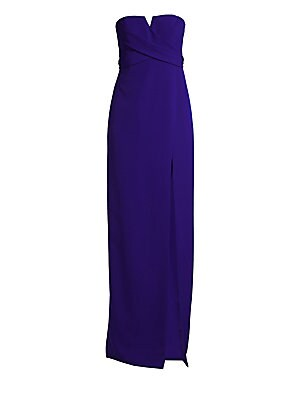 """Image of A notched neckline and thigh-high slit add an air of allure to this graceful column gown. Strapless Sleeveless Concealed back zip Lined Polyester/spandex Dry clean Imported SIZE & FIT Column silhouette About 51"""" from shoulder to hem Model shown is 5'10"""" ("""