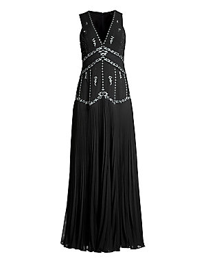 Image of An alluring neckline and empire waist add to the vintage elegance of this chiffon gown, finished with exquisite star embroidery and a flowing pleated skirt. V-neck Sleeveless Concealed back zip with hook-and-eye closures Empire waist Polyester crepe de ch