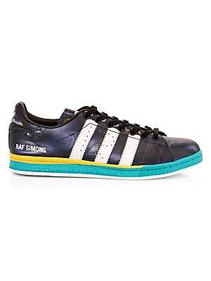 Image of Embellished with the iconic adidas stripes, these colorblock leather sneakers are imbued with a high tech aesthetic. Leather upper Round toe Lace-up vamp Leather lining Rubber sole Imported. Men's Shoes - Designer Shoes > Saks Fifth Avenue. adidas by Raf