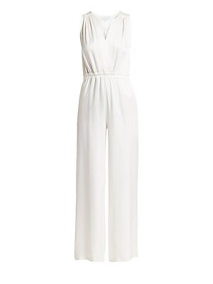 Image of Roomy legs are married to a relaxed-fit bodice on this effortless crepe satin jumpsuit. An elasticized waistband works to flatter the female form. Surplice V-neck Sleeveless Pull-on style Elasticized waistband Acetate/viscose Dry clean Made in France of I