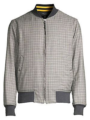 Image of Versatile bomber jacket features plaid on one side and a solid hue for another to transcend occasions. Baseball collar Long sleeves Rib-knit neck, cuffs and hem Zip front Waist snap-button welt pockets Jacket is reversible Fully lined Wool/cotton Fill: Po