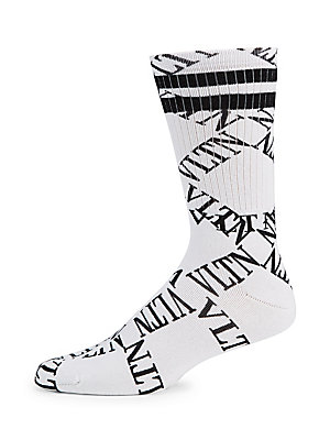 Image of Iconic rib-knit socks with allover logo graphics are framed with varsity stripes. Rib-knit leg opening Cotton/polyamide/elastane Machine wash Made in Italy. Men Accessories - Cold Weather Accessories. Valentino. Color: White Black. Size: Large/XL.