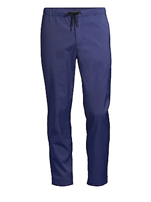 Image of The Rem pant is a refined drawstring pant that is fully constructed with heat-sealed technology to ensure a seamless, flattering fit. With an elasticized drawcord waistband and covered ankle zips, this pant is designed to move. Cut from Theory's signature