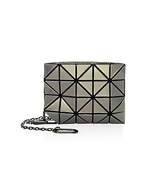 """Image of Essential wallet enhanced with signature prisms. Detachable chain lanyard Top zip closure Silvertone hardware Polyvinyl chloride/polyester/nylon Made in Japan SIZE 5.25""""W x 4.25""""H. Handbags - Collection Handbags > Saks Fifth Avenue. Bao Bao Issey Miyake."""