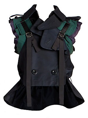 Image of Avant-garde and effortlessly chic, this cropped trench-inspired vest falls to a peplum hem. Its mixed textures and colors make it a statement piece ideal for pairing with pleated skirts or tailored trousers. Spread collar Sleeveless Front double breasted