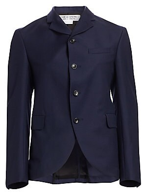 Image of A timeless wardrobe essential, this structured wool blazer flaunts an sophisticated notched collar and modern curved front, making it ideal for wearing open over a printed blouse. Notched collar Long sleeves Front button close Chest welt pocket Button cuf