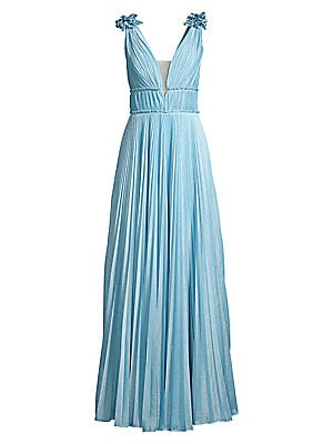 "Image of A gracefully pleated gown accentuated by a ruffled bodice and alluring back cutout. Plunging V-neck Sleeveless Concealed back zip Ruffled trim Lined Polyester Dry clean Imported SIZE & FIT Flare silhouette About 62"" from shoulder to hem Model shown is 5'1"