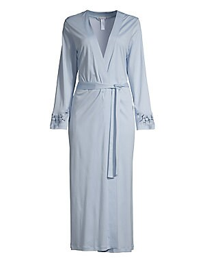 Image of Elegant wrap robe with floral lace and embroidery detailing at the sleeves. V-neck Long sleeves Wrap sash closure Floral embroidery on sleeve cuffs Mercerized cotton Soft flowing interlock with a subtle sheen Machine wash Made in Portugal from imported fa