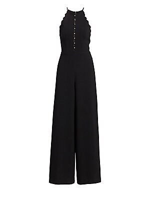 Image of Alluring cutouts and scalloped trim offer feminine geometric accents to this stretch jumpsuit in flattering wide leg silhouette. Halterneck Sleeveless Button front with cutouts Seamed waist Concealed back zip Polyester/elastane Dry clean Imported SIZE & F