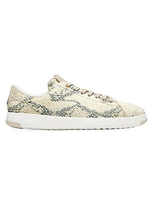 Image of A graphic anomaly, these sneakers flaunt a bold snakeskin print. Leather upper Round toe Lace-up vamp Leather lining Molded ethylene vinyl acetate sole Imported. Women's Shoes - Cole Haan Womens Shoes > Saks Fifth Avenue. Cole Haan. Color: Gold. Size: 10.