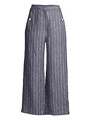 Image of The pinstripe pant is a undoubtedly a wardrobe essential for any modern woman. Here, the classic garment is crafted in linen and gifted a wide-leg silhouette with side buttons for a nautical take. Banded waist Zip fly with hook-and-eye closure Side slash