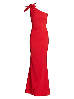 """Image of A floral detail sits atop the shoulder of this asymmetric ruched gown. One-shoulder Sleeveless Pull-on style Keyhole detail at shoulder Ruched hip Wrap skirt Polyamide/elastane Hand wash Made in Italy SIZE & FIT Mermaid silhouette About 65"""" from shoulder"""