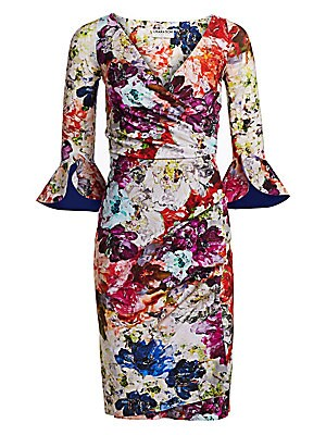 """Image of A painterly floral print adorns this ruched ruffle-sleeve wrap dress. V-neck Three-quarter sleeves with ruffle cuffs Wrap front Fitted waist Side ruching Polyamide/elastane Hand wash Made in Italy SIZE & FIT Wrap silhouette Midi length About 43.25"""" from s"""