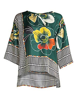 """Image of A vibrant floral and geometric print adorns luxe silk oversize blouse with modern high-low hemline. Roundneck Three-quarter sleeves Pullover style High-low hemline Silk Dry clean Made in Italy of imported fabric SIZE & FIT Oversized About 24"""" from shoulde"""