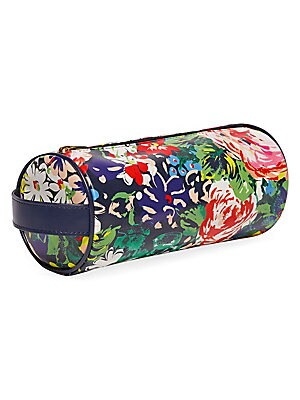 """Image of The newest way to get it together in style. This design has a cylindrical shape, is perfect for writing utensils or makeup and has a strap on the side for easy carrying. Top zip closure Side handle Polyurethane Nylon Metal Spot clean Imported SIZE 9.25""""W"""