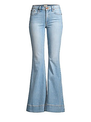 """Image of Classic mid-rise jeans fall to a chic flared bell bottom. Belt loops Zip fly Five-pocket style Bell cuffs Cotton/lyocell/polyester/elastane Machine wash Made in USA SIZE & FIT Mid rise Rise, about 9.5"""" Inseam, about 35"""" Leg opening, about 27"""" Model shown"""