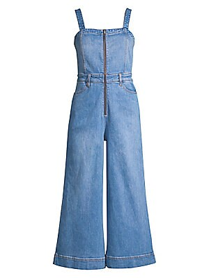 Image of '70s-inspired styling adds a vintage flair to this cropped wide-leg denim jumpsuit. Squareneck Shoulder straps Zip front Banded waist with belt loops Waist curve pockets Lined Cotton/elastane Machine wash Imported of Italian fabric SIZE & FIT Wide-leg sil