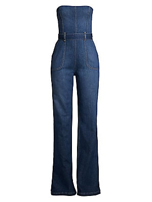 Image of 1970s-inspired strapless wide-leg denim jumpsuit accented with a bow-back detail. Squareneck Strapless Concealed back zip with self-tie back closure Banded waist with belt loops Waist patch pockets Stretch lining Cotton/elastane Dry clean Imported of Ital