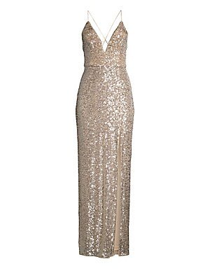Image of A plunging neckline and a daring side slit add a seductive flair to this shimmering sequin gown. V-neck Spaghetti straps Concealed back zip Fitted waist Side slit Crisscross back Lined Polyester/nylon Dry clean Imported SIZE & FIT Column silhouette About